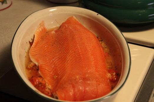 Lay salmon on top of tomato mixture.