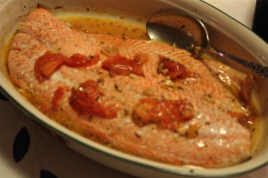 Serve salmon with tomato sauce spooned over the top.
