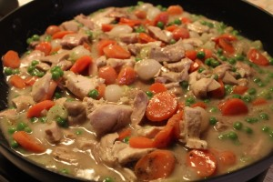 Add chicken and vegetables to the gravy.