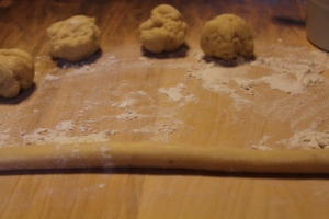 Roll small balls of dough into ropes either 5 inches or 8 inches long.