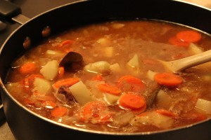 Add in carrots and potatoes and cook till tender.