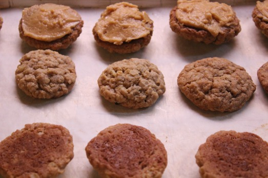 Match up cookies in pairs.  Spread filling on the bottom of one and top with the other.