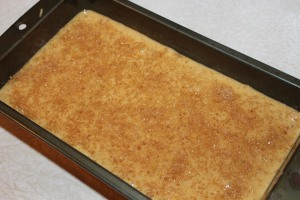 Before baking sprinkle the top of bread heavily with sugar for a nice crunchy top.