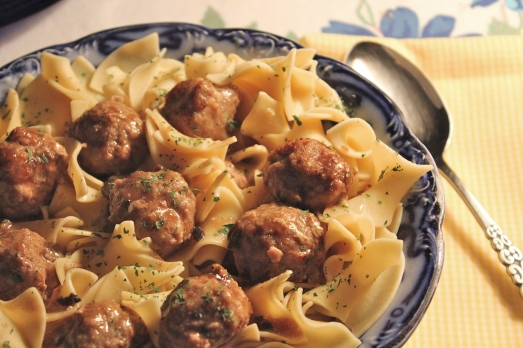Meatballs served over whole wheat egg noodles.