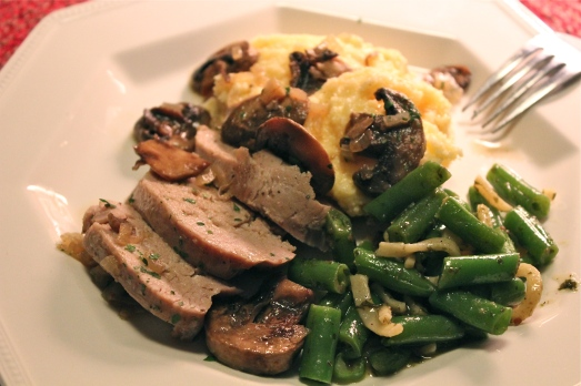 A moist cut of pork with mushroom sauce to spoon over polenta.