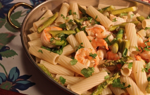Shrimp, lemon juice, and then pasta added.