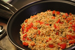 Saute onion and pepper, then add couscous.