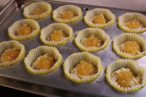 Place half the batter in muffins cups and add a teaspoon of lemon curd.