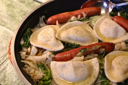 Sauted cabbage, cheddarwurst and pierogies.