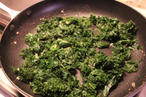 Kale with seasonings in the pan.