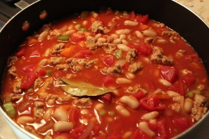 Tomatoes, sauce and beans added, plus seasonings.