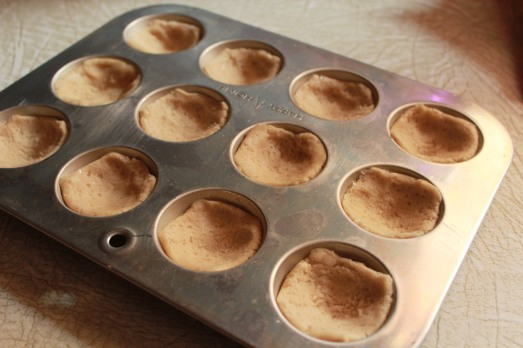 Press dough into the wells of a mini-muffin pan.