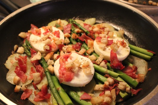 Place cooked eggs on top of   asparagus and potatoes.
