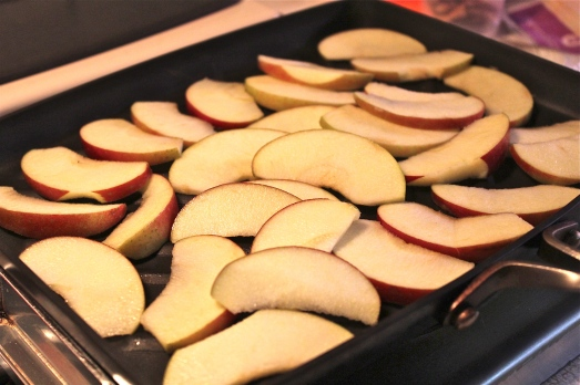Spread apples on grill pan and cook till barely tender.