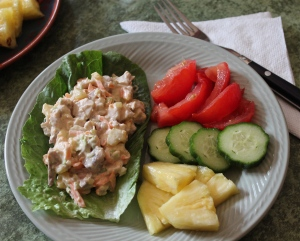 turkey salad on romaine, with tomatoes, cucumbers, and pineapple.