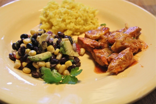 Mexican chicken, yellow rice, and black bean and corn salad.