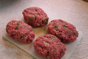 Form beef into 4 oval-shaped patties.