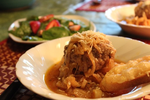 French onion Salisbury Steak, served with spinach and strawberry salad.