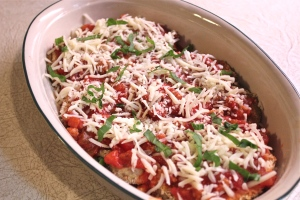 Sprinkle with grated mozzarella and chopped basil.
