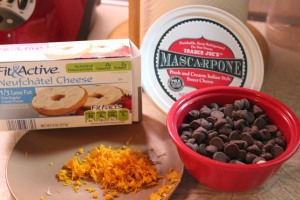 Cream cheese, mascarpone, chocolate chips and orange zest provide the flavor