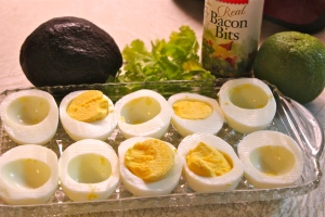 Hard-cook the eggs, remove yolks and mix with other ingredients.