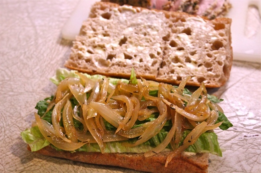 Lettuce is the first layer, followed by the onions.