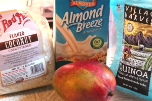 coconut flakes, almond milk, mango and quinoa make up a nutritious breakfast.