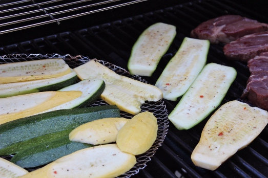 Squash slices on the grill.