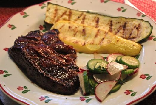 Hoisin-Glazed steak with grilled vegetables and salad.