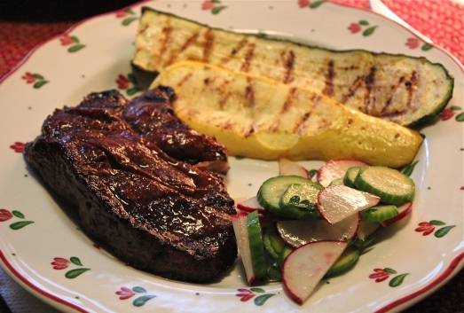 Hoisin-Glazed steak with grilled vegetables and salad.