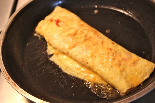 Fold the omelet in thirds and let the heat melt the cheese filling.