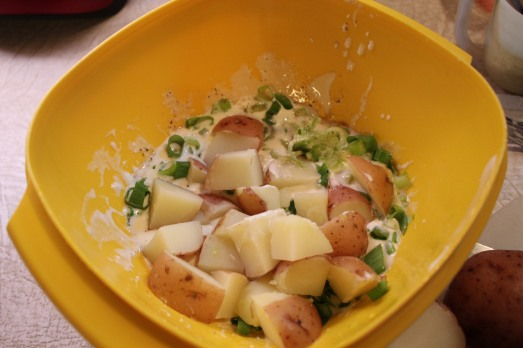 Mix potatoes together with other ingredients.
