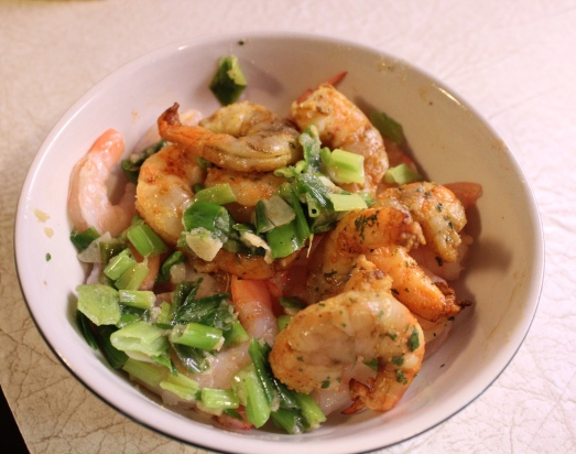 Precook the shrimp and scallions and set aside.
