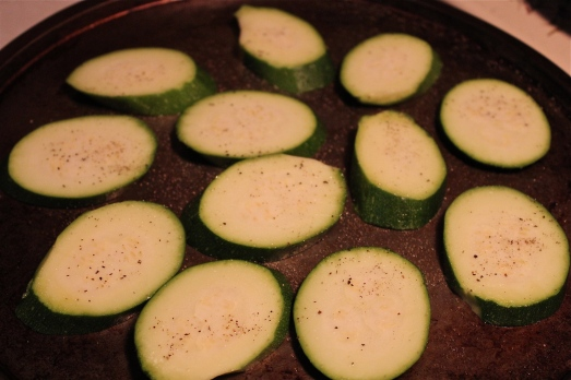 Cut zucchini into circles or ovals about 1/4-inch thick.