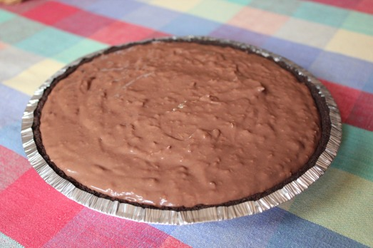 Pour the chocolate filling into a crumb crust.