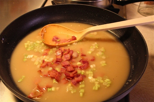 Add chicken broth, bacon and scallions.