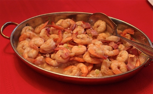 Shrimp in gravy in a serving bowl.