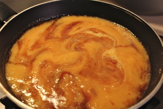 Add peach puree and blend in thoroughly.