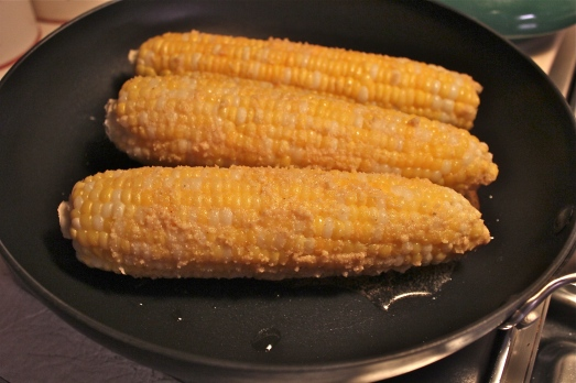 Spread the seasoned cheese on each ear and fry to brown up.