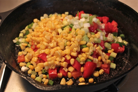 Add all the vegetables to the fry pan and mix to coat with drippings.
