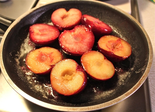 Sauté the plums in butter and sugar.