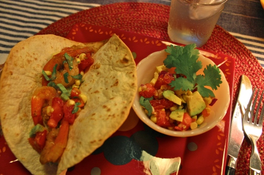 Shrimp tacos with corn and avocado salsa.