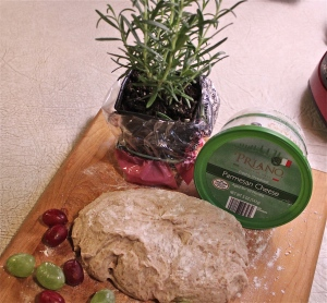 Whole wheat pizza dough, grapes, rosemary, and Parmesan cheese.