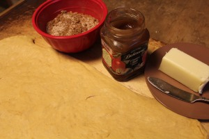 Butter, pumpkin butter, and sugar-spice mixture ready to spread on the dough.