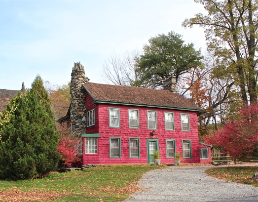 Another old red farmhouse.