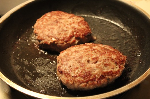 A hot pan will give a nice sear to the burgers.
