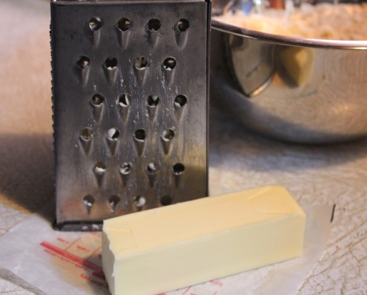 Use a box grater to add small bits of frozen butter to the dry ingredients.