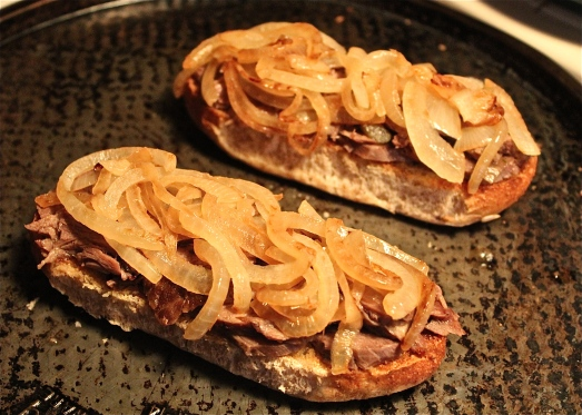 Spoon grilled onions over beef.