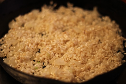 Add the rice to butter and onions and stir to coat.