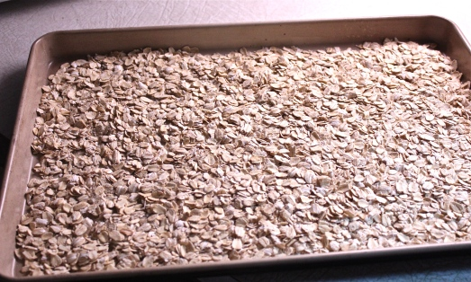 Begin by toasting the oats on a baking sheet.